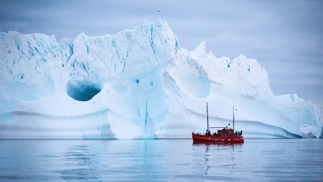 boat and iceberg near Iluissat, Greenland