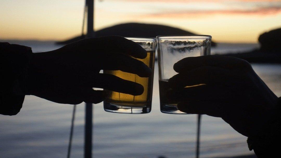 sunset drink toast on Baja beach