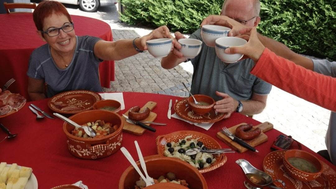 people anjoying an outdoor lunch in Portugal