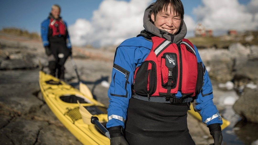 smiling woman kayaker in Greenland