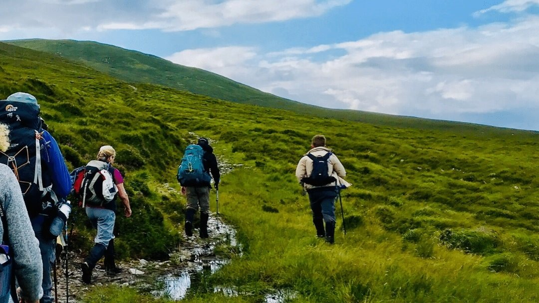 Hikers on trail along Wild Atlantic way, Ireland