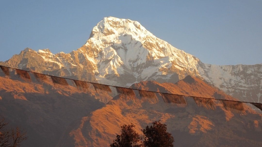 Himalaya Peak in Nepal with prayer flag in foreground