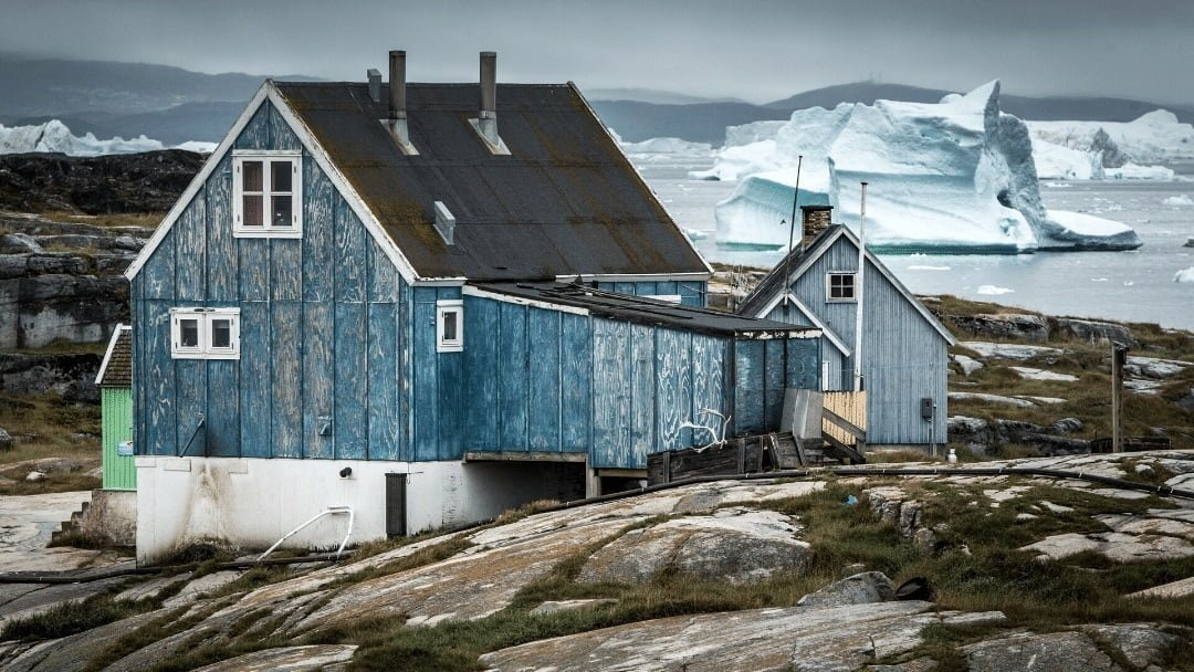 Greenland house with icebergs in backgroud