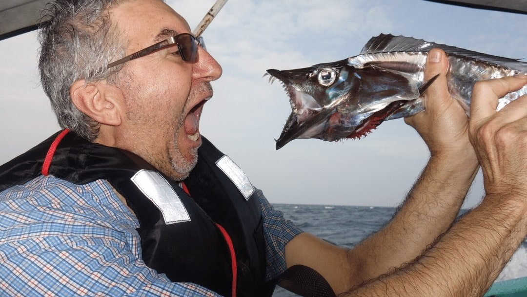 Man and fish with open mouths