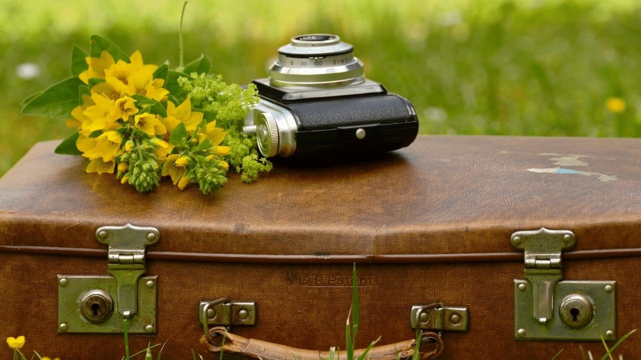 Old suitcase with camera