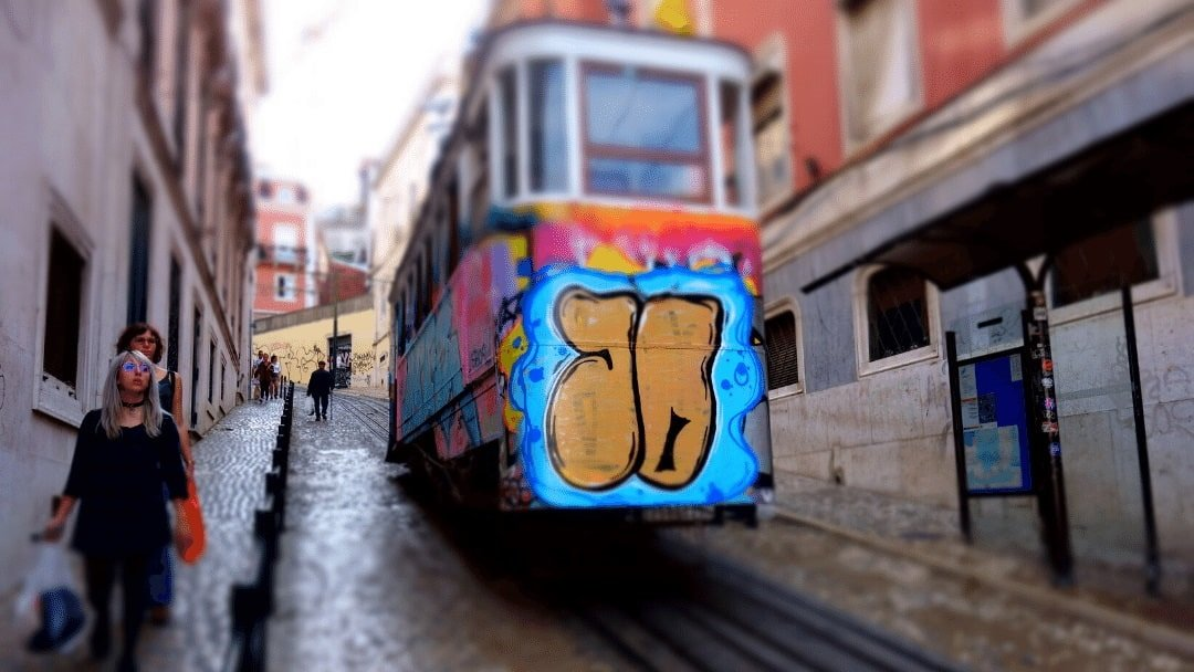 graffitied trolley on hill
