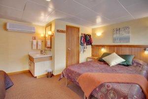 Large bed, explorer cabin on UnCruise Wilderness Discoverer