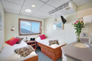 beds in large Pathfinder cabin on UnCruise Wilderness Explorer