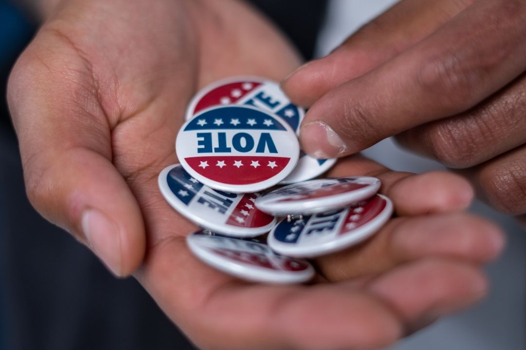 vote buttons in palm of a hand