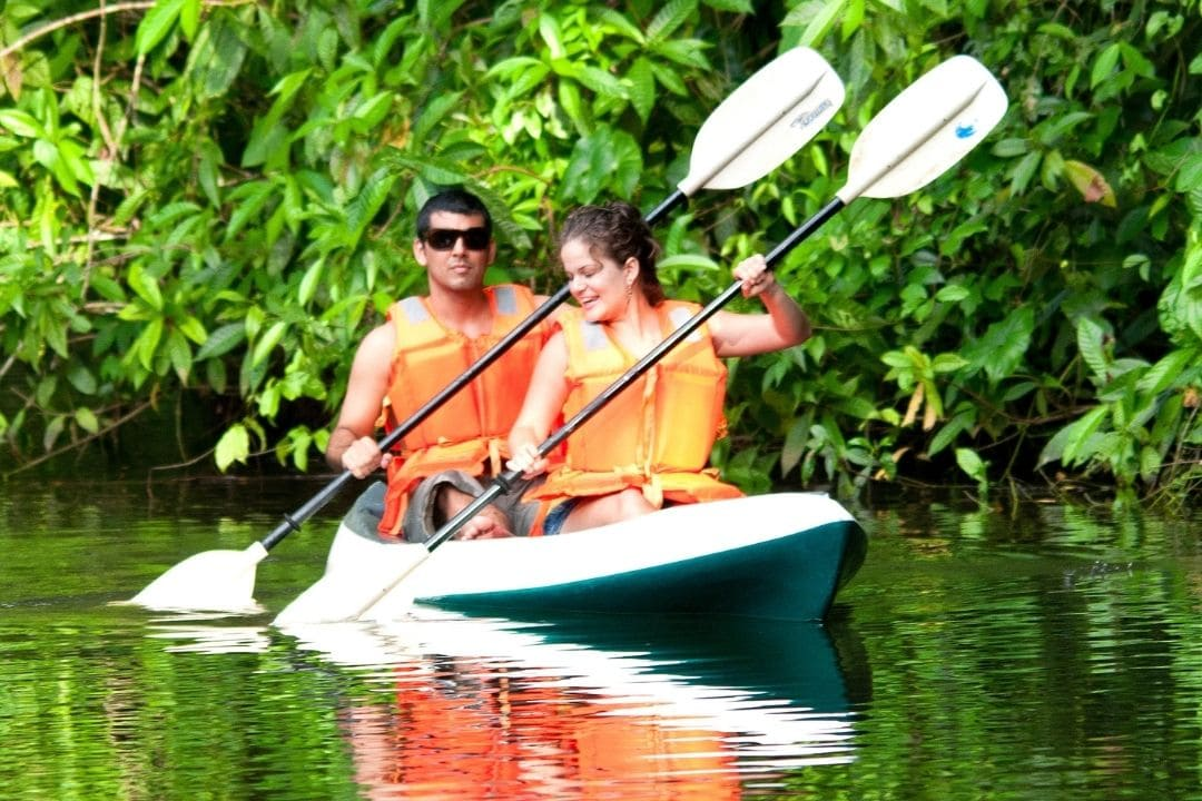 man and woman in kayak in managroves