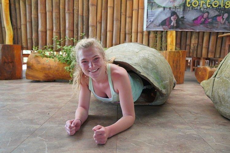 Young girl inside tortoise shell