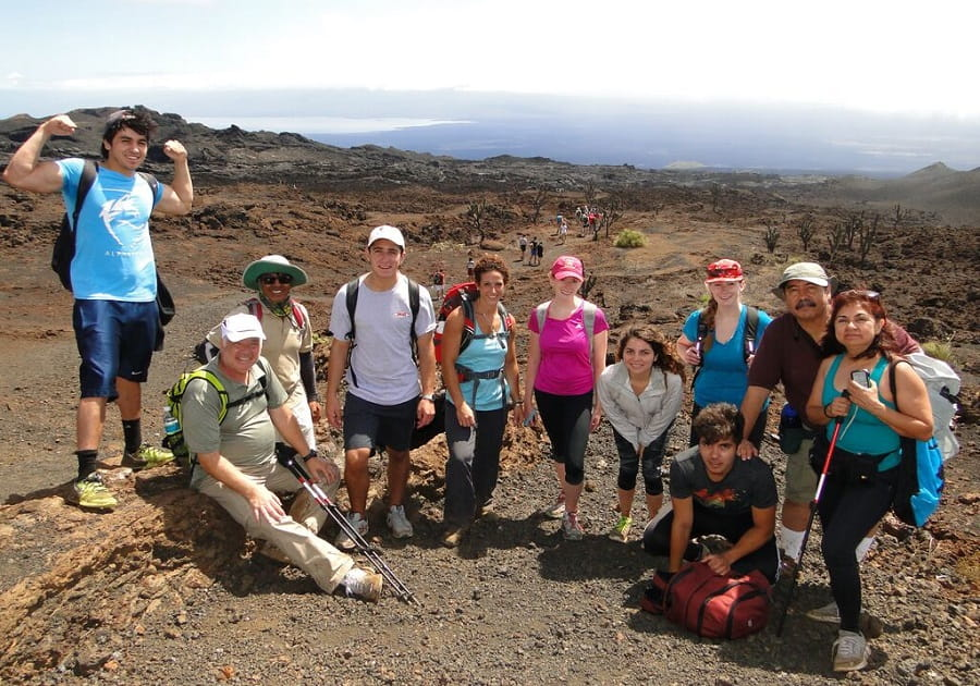 hikers on volcano in Galapagos