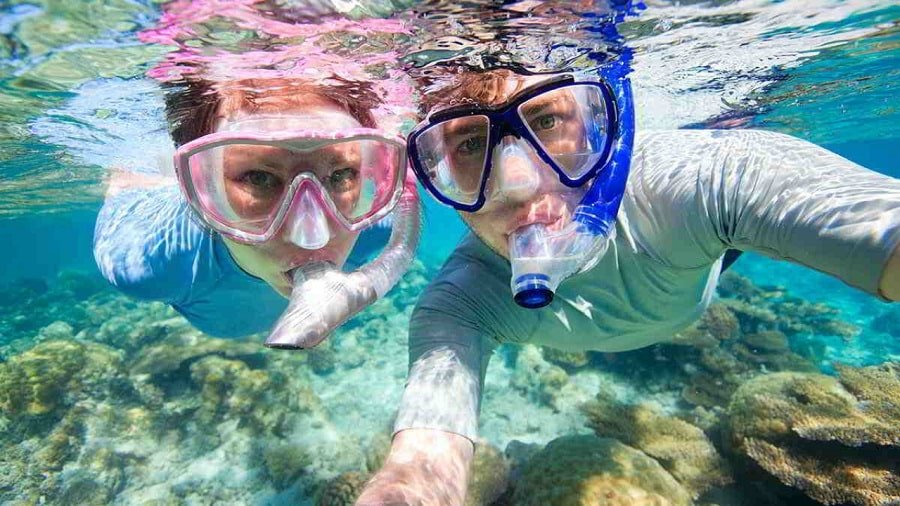 closeup of man and girl snorkeling