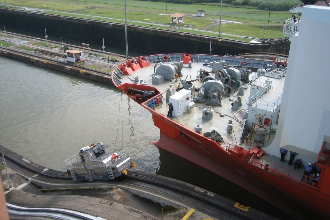 front of massive ship going through the Panama Canal
