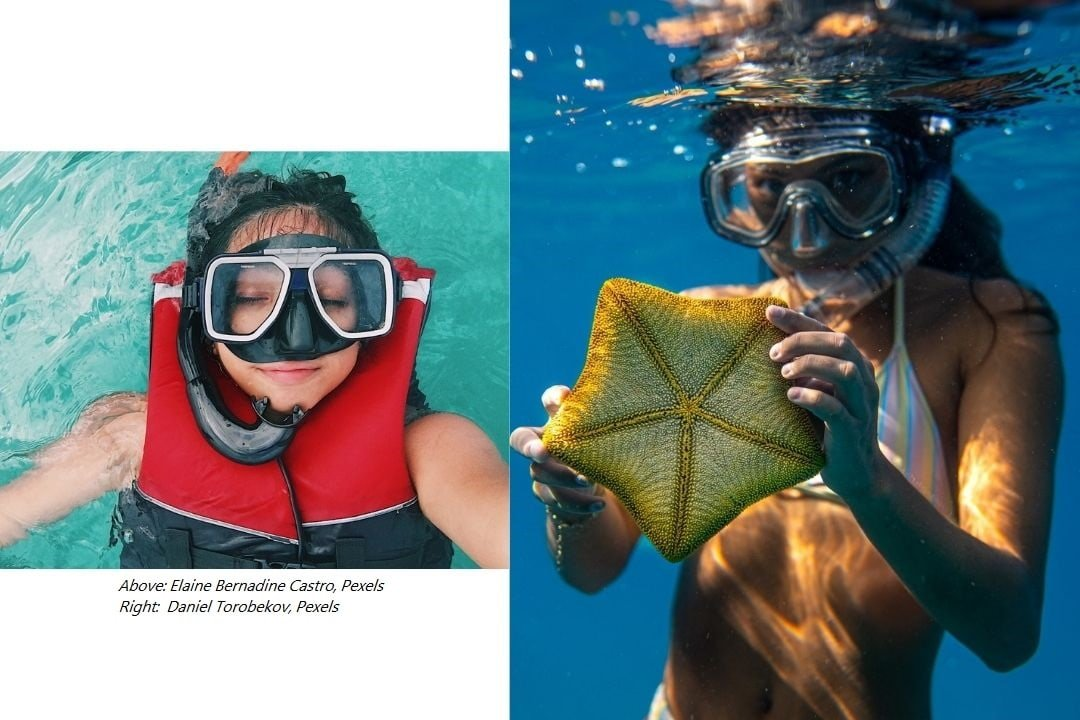 boy with snorkel and life vest and girl with snorkel and starfish