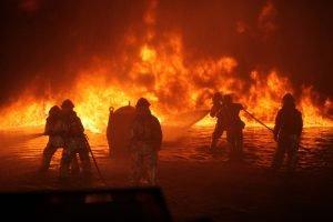 firemen battling a forest blaze