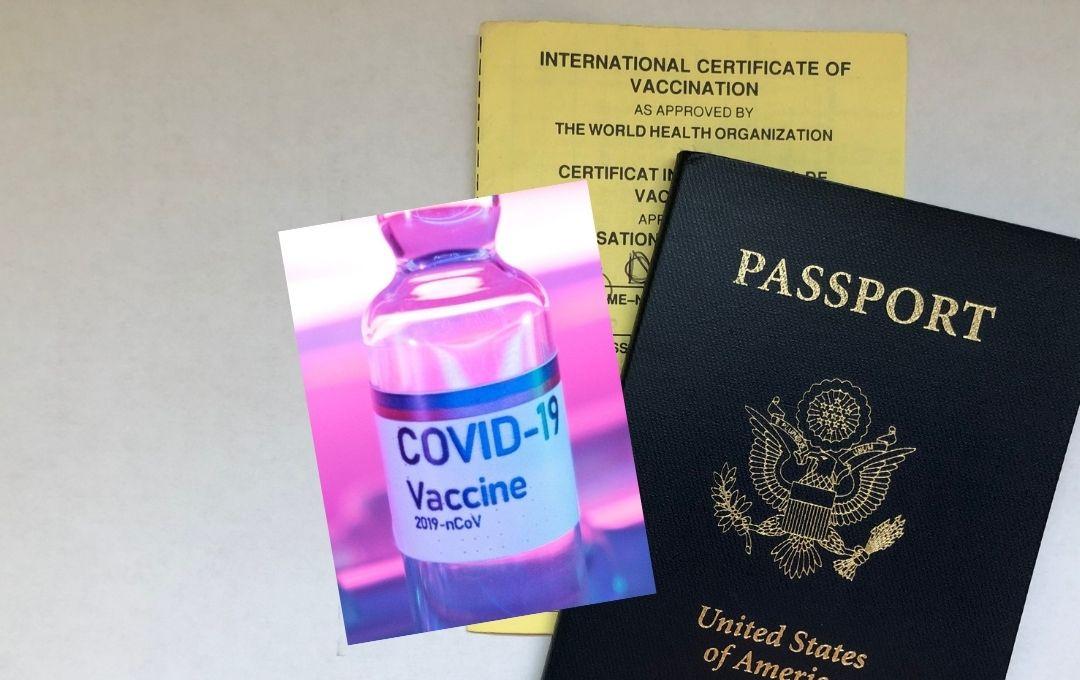 passport and covid-19 vaccine vial